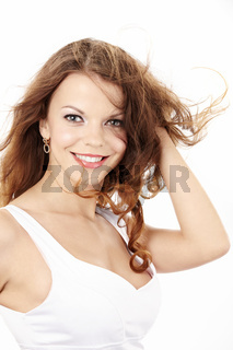 Portrait of the positive curly smiling girl isolated