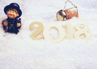 Wooden number 2018 in snow