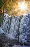 Sunshine over Wild waterfall in Karpacz