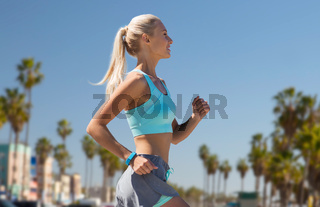 woman with fitness tracker running