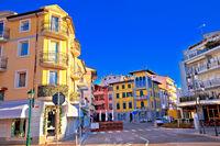 Town of Grado tourist promenade street colorful architecture view