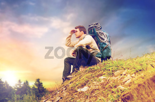 traveler with backpack hiking over sky background