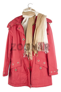 Old red female jacket hangs on a hanger