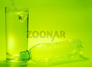 Glass full of water and empty bottle