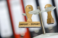 import - export printed on rubber stamp in office