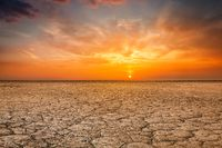 Cracked earth soil sunset landscape