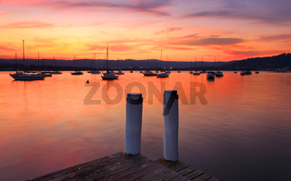 Boats on the harbour at sunset