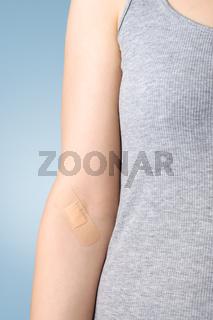 Plaster on female arm