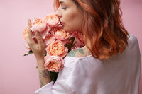 Girl with pink flowers ranunculus