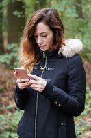 young woman using mobile smartphone outdoors