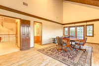 Bright, open and warm bonus room upstairs with vaulted ceilings
