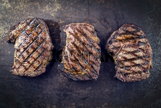 Barbecue Rib-Eye Steak on old Metall Sheet