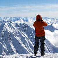 Skier on top of snowy mountain