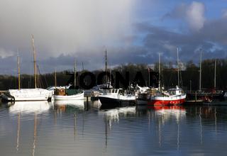 Sailing ships resting at the bay