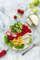 Vegetable salad with pasta and artisanal cheese.