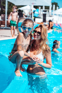 Mother and little girl in the pool