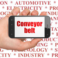 Manufacuring concept: Hand Holding Smartphone with Conveyor Belt on display