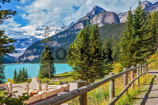 Low wooden fence on the shore of Lake Louise