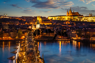 Night view of Prague castle and Charles Bridge over Vltava river