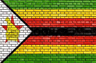 flag of Zimbabwe painted on brick wall