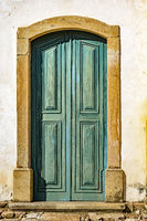 Old blue and green wooden church door