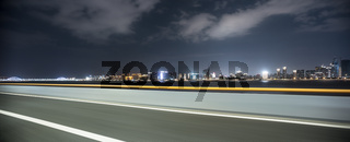 cityscape and skyline of hangzhou from empty road