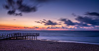 Sunset over wooden pier panorama