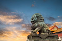 china bronze lion in sunset
