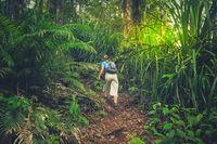 Girl walking up the jungle path to the summit of Gunung Rinjani volcano