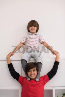 young boys posing line up piggyback