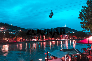 Evening view of Tbilisi and the Kura river at dusk