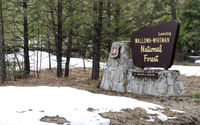 Fresh snow stands around the sign at Wallowa-Whitman National Forest