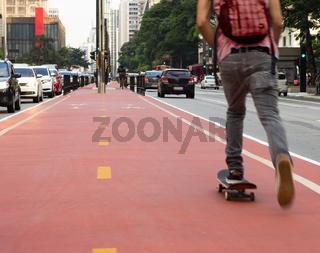 Skater in city center. Red lane.