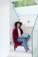 freelancer in bathrobe working from home