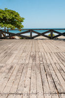 wooden terrace with beach, ocean  and blue sky background -