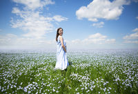 Young beautiful pregnant woman in linen field