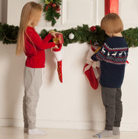 Children opens Christmas stocking