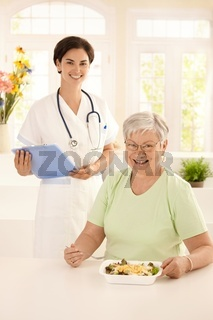 Healthy elderly woman eating salad