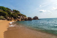 Tropical rock Coral Cove beach with coconut palm trees. Koh Samui, Thailand.