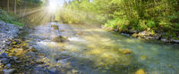 panorama scene in Bavaria with river in canyon and sunbeams