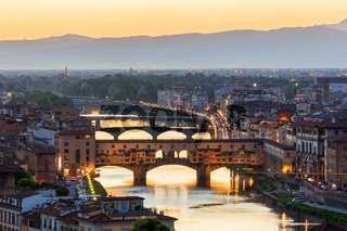 View of the Ponte Vecchio bridge over the Arno River in Florence with floodlight
