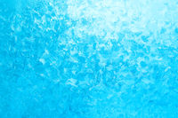 Light blue frozen window glass