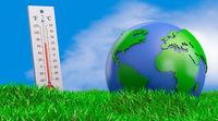 Thermometer and globe on the grass