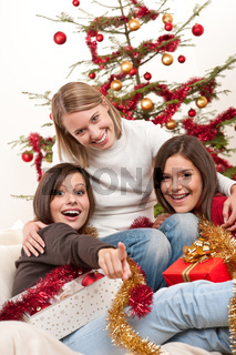 Three young women having fun on Christmas