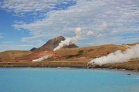 Turquoise thermal lake near Reykjahlid, Iceland. Old powerhouse.