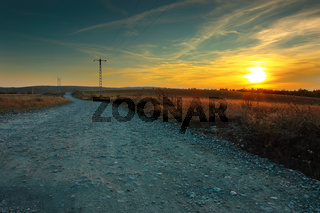 view of a rural road at sunset