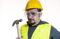 Do it yourself, man dressed in yellow builder helmet with protective glasses ready to start the construction work