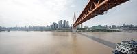 modern suspension bridge over river in modern city