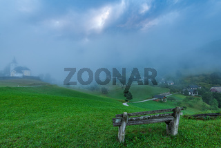 Empty bench overlooking Sorica village in Slovenia