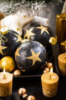 Christmas balls with candles in golden tone